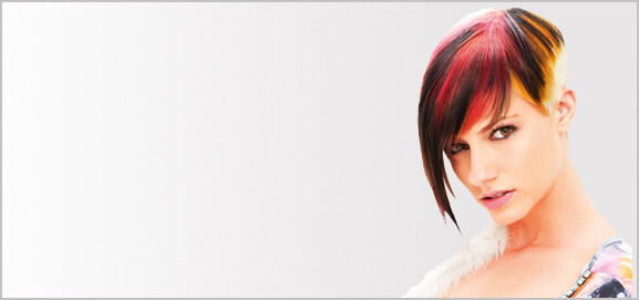 Female hair model with short dark brown hair and red and orange highlights.